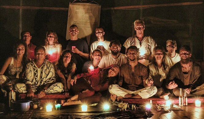 Group in candlelight at retreat